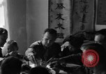 Image of American soldiers dine with Chinese children China, 1943, second 52 stock footage video 65675053427