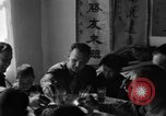 Image of American soldiers dine with Chinese children China, 1943, second 54 stock footage video 65675053427