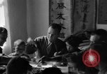 Image of American soldiers dine with Chinese children China, 1943, second 56 stock footage video 65675053427