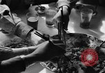 Image of American soldiers dine with Chinese children China, 1943, second 58 stock footage video 65675053427