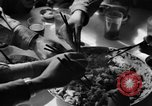 Image of American soldiers dine with Chinese children China, 1943, second 59 stock footage video 65675053427