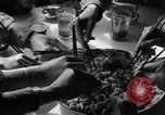 Image of American soldiers dine with Chinese children China, 1943, second 60 stock footage video 65675053427