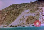 Image of Rocky shoreline Okinawa Pacific Theater Kerama Retto, 1945, second 23 stock footage video 65675053456