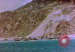 Image of Rocky shoreline Okinawa Pacific Theater Kerama Retto, 1945, second 26 stock footage video 65675053456