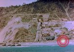 Image of Rocky shoreline Okinawa Pacific Theater Kerama Retto, 1945, second 33 stock footage video 65675053456