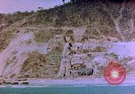 Image of Rocky shoreline Okinawa Pacific Theater Kerama Retto, 1945, second 36 stock footage video 65675053456