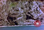 Image of Rocky shoreline Okinawa Pacific Theater Kerama Retto, 1945, second 42 stock footage video 65675053456