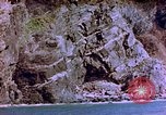 Image of Rocky shoreline Okinawa Pacific Theater Kerama Retto, 1945, second 44 stock footage video 65675053456
