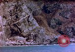Image of Rocky shoreline Okinawa Pacific Theater Kerama Retto, 1945, second 48 stock footage video 65675053456