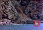 Image of Rocky shoreline Okinawa Pacific Theater Kerama Retto, 1945, second 49 stock footage video 65675053456
