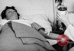 Image of wounded soldiers Pacific Theater, 1944, second 23 stock footage video 65675053487