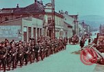Image of German troops marching to surrender to Western Allies Pilsen Czechoslovakia, 1945, second 19 stock footage video 65675055608