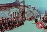 Image of German troops marching to surrender to Western Allies Pilsen Czechoslovakia, 1945, second 26 stock footage video 65675055608