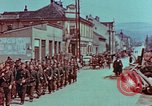 Image of German troops marching to surrender to Western Allies Pilsen Czechoslovakia, 1945, second 27 stock footage video 65675055608