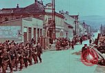 Image of German troops marching to surrender to Western Allies Pilsen Czechoslovakia, 1945, second 33 stock footage video 65675055608