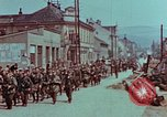Image of German troops marching to surrender to Western Allies Pilsen Czechoslovakia, 1945, second 56 stock footage video 65675055608