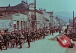 Image of German troops marching to surrender to Western Allies Pilsen Czechoslovakia, 1945, second 57 stock footage video 65675055608