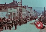 Image of German troops marching to surrender to Western Allies Pilsen Czechoslovakia, 1945, second 58 stock footage video 65675055608