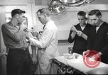 Image of navy personnel United States USA, 1953, second 3 stock footage video 65675061079