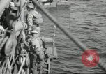 Image of US forces landing on Normandy beaches on D-Day France, 1944, second 15 stock footage video 65675061279