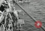 Image of US forces landing on Normandy beaches on D-Day France, 1944, second 16 stock footage video 65675061279