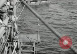 Image of US forces landing on Normandy beaches on D-Day France, 1944, second 19 stock footage video 65675061279
