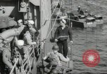 Image of US forces landing on Normandy beaches on D-Day France, 1944, second 26 stock footage video 65675061279