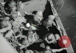 Image of US forces landing on Normandy beaches on D-Day France, 1944, second 39 stock footage video 65675061279