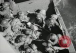 Image of US forces landing on Normandy beaches on D-Day France, 1944, second 40 stock footage video 65675061279