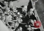 Image of US forces landing on Normandy beaches on D-Day France, 1944, second 41 stock footage video 65675061279