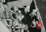 Image of US forces landing on Normandy beaches on D-Day France, 1944, second 48 stock footage video 65675061279