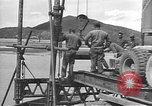 Image of American Army Corps of engineers rebuilding a bridge in South Korea during hostilities Korea, 1951, second 7 stock footage video 65675061713