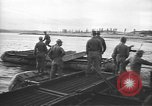 Image of American Army Corps of engineers rebuilding a bridge in South Korea during hostilities Korea, 1951, second 13 stock footage video 65675061713