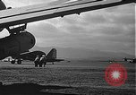 Image of U.S. military aircraft on Ford Island Pearl Harbor Hawaii USA, 1942, second 59 stock footage video 65675061838