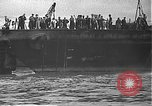 Image of USS California (BB-44) being moved to drydock Pearl Harbor Hawaii USA, 1942, second 4 stock footage video 65675061839