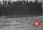 Image of USS California (BB-44) being moved to drydock Pearl Harbor Hawaii USA, 1942, second 6 stock footage video 65675061839