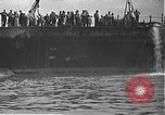 Image of USS California (BB-44) being moved to drydock Pearl Harbor Hawaii USA, 1942, second 11 stock footage video 65675061839