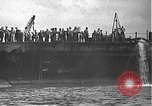 Image of USS California (BB-44) being moved to drydock Pearl Harbor Hawaii USA, 1942, second 13 stock footage video 65675061839
