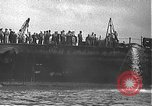 Image of USS California (BB-44) being moved to drydock Pearl Harbor Hawaii USA, 1942, second 14 stock footage video 65675061839