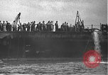 Image of USS California (BB-44) being moved to drydock Pearl Harbor Hawaii USA, 1942, second 15 stock footage video 65675061839