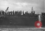 Image of USS California (BB-44) being moved to drydock Pearl Harbor Hawaii USA, 1942, second 16 stock footage video 65675061839