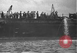 Image of USS California (BB-44) being moved to drydock Pearl Harbor Hawaii USA, 1942, second 17 stock footage video 65675061839
