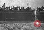 Image of USS California (BB-44) being moved to drydock Pearl Harbor Hawaii USA, 1942, second 19 stock footage video 65675061839