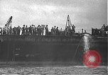 Image of USS California (BB-44) being moved to drydock Pearl Harbor Hawaii USA, 1942, second 20 stock footage video 65675061839
