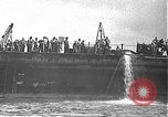 Image of USS California (BB-44) being moved to drydock Pearl Harbor Hawaii USA, 1942, second 21 stock footage video 65675061839
