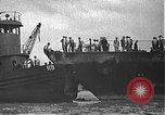 Image of USS California (BB-44) being moved to drydock Pearl Harbor Hawaii USA, 1942, second 22 stock footage video 65675061839