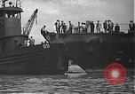 Image of USS California (BB-44) being moved to drydock Pearl Harbor Hawaii USA, 1942, second 23 stock footage video 65675061839
