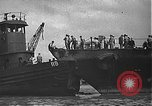 Image of USS California (BB-44) being moved to drydock Pearl Harbor Hawaii USA, 1942, second 24 stock footage video 65675061839