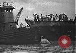 Image of USS California (BB-44) being moved to drydock Pearl Harbor Hawaii USA, 1942, second 25 stock footage video 65675061839