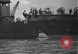 Image of USS California (BB-44) being moved to drydock Pearl Harbor Hawaii USA, 1942, second 28 stock footage video 65675061839